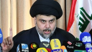 """Iraqi Shiite cleric Moqtada al-Sadr delivers a speech from the southern Iraqi city of Najaf on February 18, 2014. Al-Sadr slammed Iraq's government as corrupt and headed by a """"dictator"""" while calling on citizens to vote, just days after announcing his exit from politics AFP PHOTO/HAIDAR HAMDANI"""