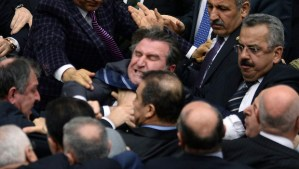 Turkish legislators from Prime Minister Recep Tayyip Erdogan's ruling party and the main opposition Republican People's Party brawl during a tense all-night debate over a controversial law on changes to a council that appoints and overseas judges and prosecutors, in Ankara, early Saturday, Feb. 15, 2014. One legislator suffered a broken finger while another suffered a nose-bleed. Opposition parties say the bill would give the government wider controls over the council.(AP Photo)