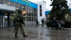 Armed men patrol at the airport in Simferopol, Crimea February 28, 2014. A group of armed men in military uniforms have seized the main regional airport in Simferopol, Crimea, Interfax news agency said early on Friday. REUTERS/David Mdzinarishvili (UKRAINE - Tags: POLITICS CIVIL UNREST TRANSPORT)