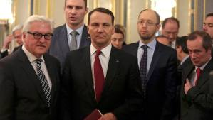 Poland's Foreign Minister Radoslaw Sikorski (C), German counterpart Frank-Walter Steinmeier (L), Ukraine's opposition leaders Vitaly Klitschko (2nd L) and Arseny Yatsenyuk (2nd R) prepare to leave after signing an EU-mediated peace deal with President Viktor Yanukovich, aiming to end a violent standoff that has left dozens dead and opening the way for a early presidential election this year, at the presidential headquarters in Kiev February 21, 2014. Russian-backed Yanukovich - under pressure to quit from the mass demonstrations in Kiev - earlier offered a series of concessions to his pro-European opponents, including a national unity government and constitutional change to reduce his powers, as well as the presidential vote. REUTERS/Konstantin Chernichkin (UKRAINE - Tags: POLITICS CIVIL UNREST)