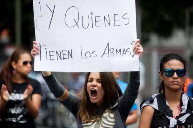 Venezuela seeks protest leader's arrest after unrest kills 3