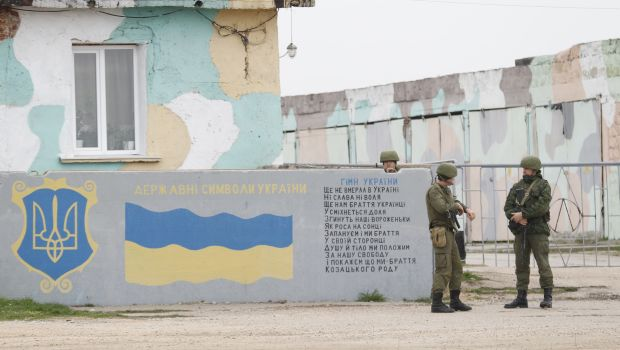 Putin: Troops to bases; warning shots in Crimea