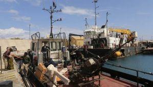 Rebels under Ibrahim Jathran unload ammunition from a boat at the Sidra port in Ras Lanuf on March 11, 2014. (Reuters/Esam Omran Al-Fetori)