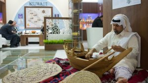 A man builds a traditional wooden ship at Kuwait's booth during the International Tourism Fair (ITB) in Berlin, Germany, on March 6, 2014. (EPA/INGA KJER)