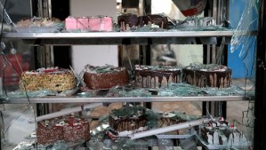 Cakes are seen inside a broken refrigerator in a patisserie shop, damaged by a deadly car bomb that exploded in early February in the predominately Shi'ite town of Hermel, about 10 miles (16 kilometers) from the Syrian border in northeast Lebanon. (AP Photo/Hussein Malla)