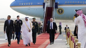 US President Barack Obama (L) is welcomed by Prince Khaled Bin Bandar Bin Abdul Aziz, Emir of Riyadh (3rdL), upon his arrival at King Khalid International Airport in Riyadh, Saudi Arabia, on March 28, 2014. Obama arrived in Riyadh for talks with Saudi King Abdullah as mistrust fuelled by differences over Iran and Syria overshadows a decades-long alliance between their countries. AFP PHOTO / SAUL LOEB