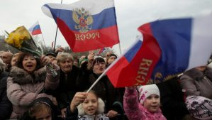 Pro-Russian supporters wave Russian flags during a concert in the centre of Sevastopol, Crimea, Ukraine, on March 8, 2014. (EPA/ZURAB KURTSIKIDZE)