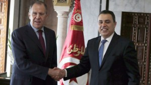 Tunisian Prime Minister Mehdi Jomaa (R), greets Russian Foreign Minister Sergey Lavrov in Tunis on March 4, 2014. (AP Photo/Hassene Dridi)