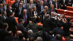 Members of parliament from the ruling Ak Party (AKP) and the main opposition Republican People's Party (CHP) scuffle during a debate on a draft law at a parliamentary session in Ankara early February 28, 2014. REUTERS/Stringer (TURKEY - Tags: POLITICS CIVIL UNREST)