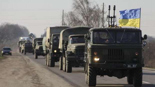Merkel raps Putin as Russian forces tighten grip on Crimea