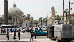 Egyptian police deploy outside of Cairo University a day after a series of three bombs went off in Giza, Egypt, on Thursday, April 3, 2014. (AP Photo/Ahmed Abdel Fattah, El Shorouk)