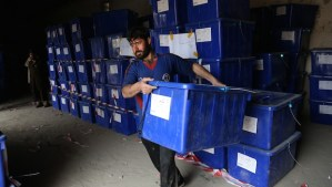 In this Wednesday, April 2, 2014, file photo an Afghan election worker carries a ballot box at an election commission office in Jalalabad, east of Kabul, Afghanistan. (AP Photo/Rahmat Gul, File)