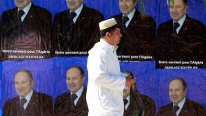 A man walks past electoral posters of the current Algerian president and candidate in the forthcoming presidential election, Abdelaziz Bouteflika, in Ain Ouassara, southwest of Algiers, on April 10, 2014. (REUTERS/Louafi Larbi)
