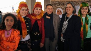 Pro-Kurdish Peace and Democracy Party (BDP) mayoral candidate for Diyarbakir city Gultan Kisanak (2nd R) and candidate for Baglar neigborhood Birsen Kaya Akat (4th L) pose with local women during an election campaign in Diyarbakir on February 26, 2014. (REUTERS/Stringer)