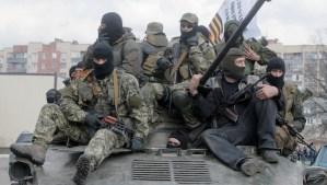 A combat vehicle with pro-Russian gunman on top drives through Slovyansk on Wednesday, April 16, 2014. (AP Photo/Efrem Lukatsky)