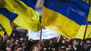 A Ukrainian student waves his national flag during a nationalist and pro-unity rally in the eastern city of Lugansk on April 17, 2014. (AFP PHOTO/DIMITAR DILKOFF)