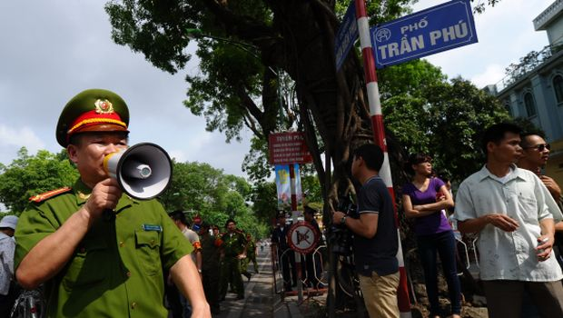 Vietnam stops anti-China protests after riots, China evacuates workers