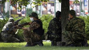 Pro-Russian rebels of the Battalion Vostok take positions outside the local administration building in the eastern Ukrainian city of Donetsk, on May 29, 2014. (REUTERS/Yannis Behrakis)