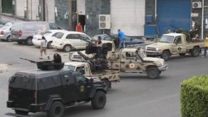 In this image, made from video provided by the Libyan national army via AP Television, shows Tripoli joint security forces on vehicles with heavy artillery standing guard near the Libyan parliament on May 18, 2014. (AP Photo/Libyan national army)