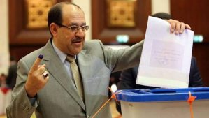 A handout picture released by the Prime Minister's Office shows Prime Minister Nuri Al-Maliki casting his ballot during the Iraqi legislative election at a polling station in the green zone in Baghdad, Iraq, on April 30, 2014. (EPA/PRIME MINISTER)