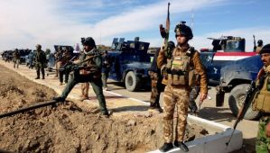 This February 2, 2014, file photo shows Iraqi security forces preparing to attack Al-Qaeda positions in Ramadi, 70 miles (115 kilometers) west of Baghdad, Iraq. (AP Photo, File)