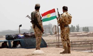 Members of the Kurdish security forces stand at a checkpoint during an intensive security deployment on the outskirts of Kirkuk on June 11, 2014. (REUTERS/Ako Rasheed)