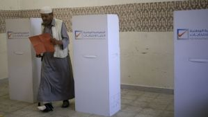 A man leaves a voting booth during a parliamentary election in Benghazi, Libya, on June 25, 2014. (REUTERS/Esam Omran Al-Fetori)