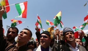 Iraqi Kurdish protesters wave the flag of their autonomous Kurdistan region during a demonstration for independence on July 3, 2014, outside the Kurdistan parliament building in Erbil(AFP PHOTO/SAFIN HAMED)