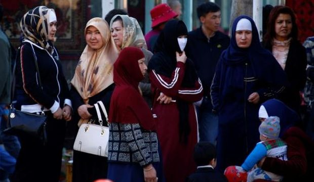 China bans beards, veils from Xinjiang city's buses in security bid