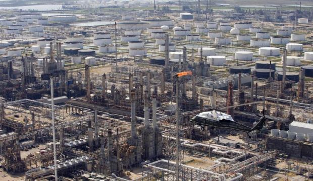 Oil prices fall below $100 per barrel for first time in 14 months