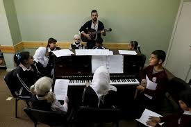 Palestinians Teach Blind Students English via Music