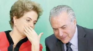 Brazilian President Dilma Rousseff talking to the Vice President Michel Temer, who will take over the rule next month