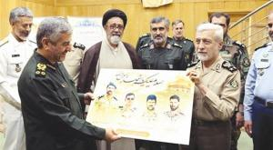 Iranian Army commader Salehi holding a poster of dead Iranian Army soldiers, who died in Syria , showing it to IRGC commander (Defense Press Website)