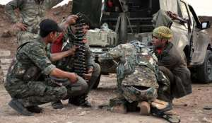 Kurdish People's Protection Units YPG fighters prepare their weapons in Ras Al-Ain countryside, Photo,Reuters