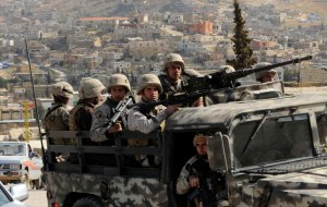 Lebanese army soldiers patrol on their armored vehicle the Sunni Muslim border town of Arsal, in eastern Bekaa Valley March 20, 2014. REUTERS/HASSAN ABDALLAH/FILES