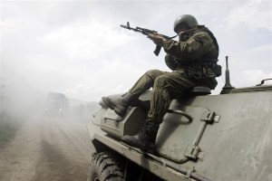 A member of Russia's special police, OMON, sits on an armored vehicle during a drill in the southern Russian city of Stavropol on May 30, 2008