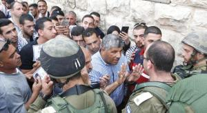 Waleed Assaf speaking to Israeli security forces in al-Khalil area, yesterday
