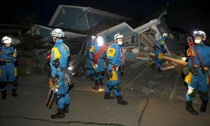 Police officers check collapsed house after an earthquake in Mashiki town, Kumamoto prefecture, southern Japan