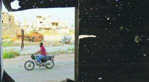 A picture taken from a window in Syria showing bullet holes marks throughout the building, Reuters