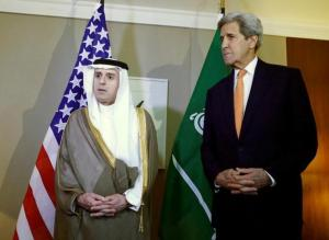 Saudi Foreign Minister al-Jubeir talks next to US Secretary of State Kerry during a meeting on Syria in Geneva