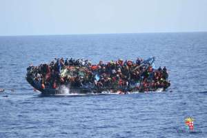 This picture released on May 25 by the Italian navy shows the shipwreck of an overcrowded boat of migrants off the Libyan coast.