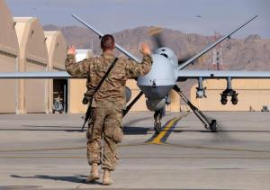 A U.S. airman guides a U.S. Air Force MQ-9 Reaper drone as it taxis to the runway at Kandahar Airfield, Afghanistan March 9, 2016. REUTERS/Josh Smith/Files