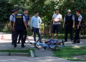 Police officers detain a man after an attack in the centre of Almaty, Kazakhstan, July 18, 2016. REUTERS/Shamil Zhumatov