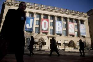 """A """"Jobs"""" banner hangs outside the U.S. Chamber of Commerce in Washington, D.C., U.S.(Photo by Andrew Harrer/Bloomberg)"""
