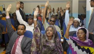 Somalia lawmakers raise their hands during a confidence vote on Prime Minister Abdiweli Sheikh Ahmed, at the Parliament Building in Mogadishu, Somalia,