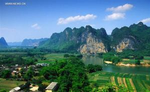 File photo provided by the UNESCO official website shows a view of Huashan Rock Art Cultural Landscape along the Zuojiang River in south China's Guangxi Zhuang Autonomous Region