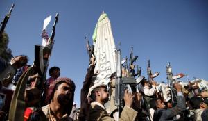 Followers of the Houthi group raise their weapons as they demonstrate against an arms embargo imposed by the U.N. Security Council on the group in Sanaa