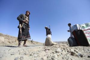 Shi'ite Houthi rebels man a checkpoint at the southern entrance to the city of Sanaa