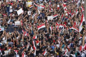People shout slogans during a demonstration at Tahrir Square in central Baghdad
