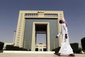 A man walks past the headquarters of Saudi Basic Industries Corp (SABIC) in Riyadh October 27, 2013. REUTERS/Faisal Al Nasser